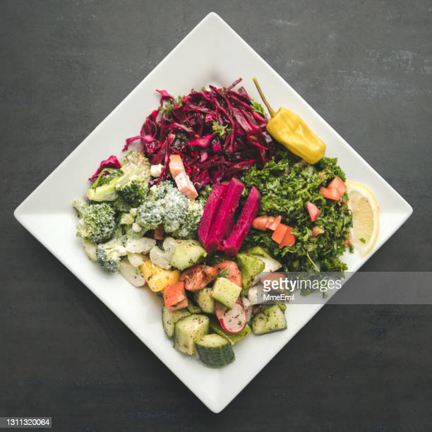 healthy lunch, assortment of colorful raw and vegan salads - mmeemil stock pictures, royalty-free photos & images