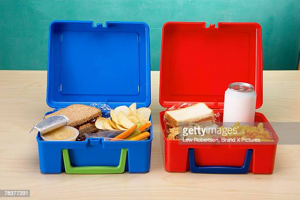 Healthy lunchbox and junk food lunchbox