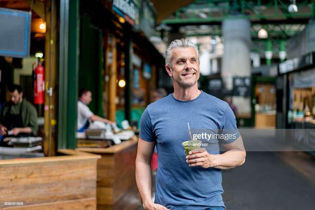 Healthy man having a smoothie : Stock Photo