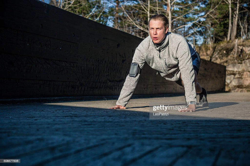 Healthy man push up on the ground in early morning : Stock Photo