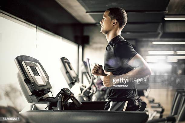 healthy man running on treadmill - gym stock pictures, royalty-free photos & images