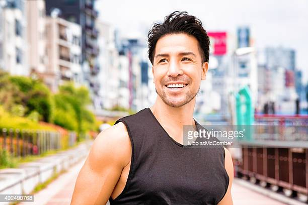 Healthy mature Japanese man portrait exercising in Tokyo