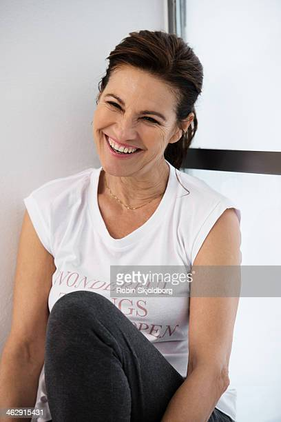 healthy mature woman sitting in window laughing - old women in pantyhose stock pictures, royalty-free photos & images