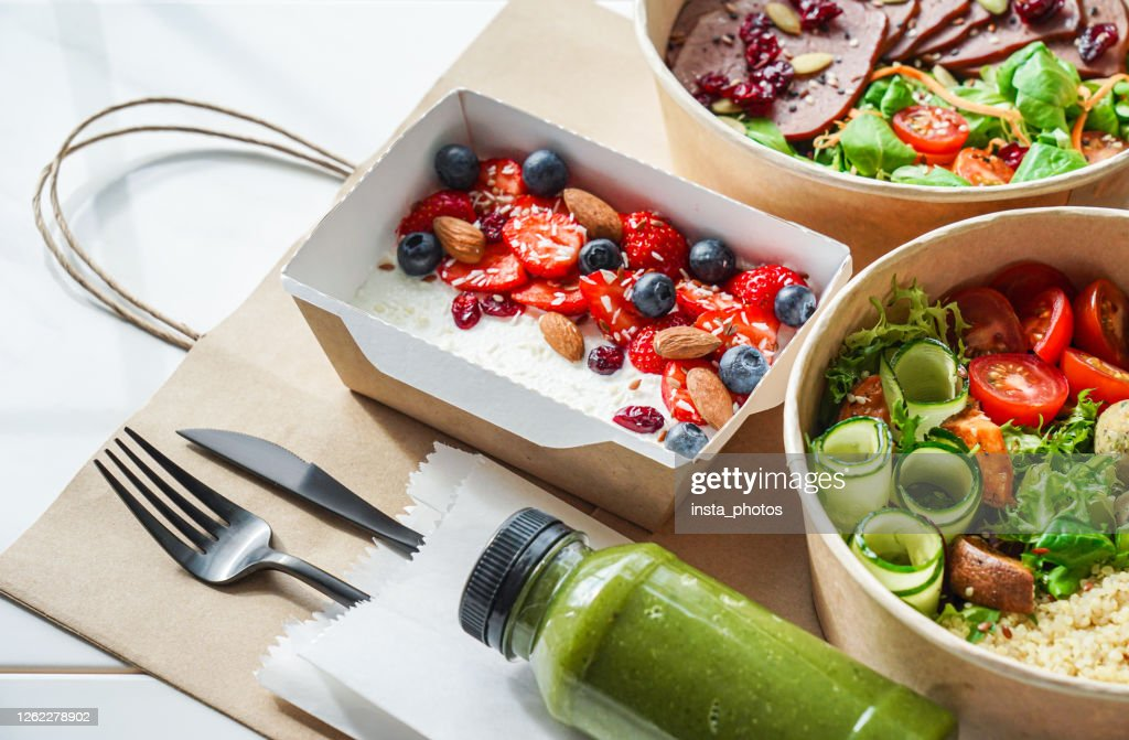 Healthy meal slimming diet plan daily ready menu background, organic fresh dishes and smoothie, fork knife on paper eco bag as food delivery courier service at home in office concept, close up view. : Stock Photo