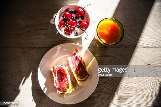 healthy morning breakfast with fruits and spanish ham. - mediterranean culture stock pictures, royalty-free photos & images