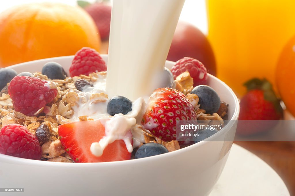 Healthy muesli breakfast with milk : Stock Photo