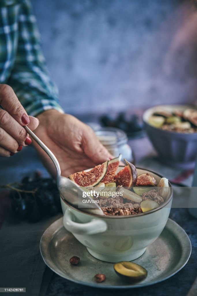 Healthy Muesli With Fresh Figs Banana And Grapes For Breakfast High Res Stock Photo Getty Images