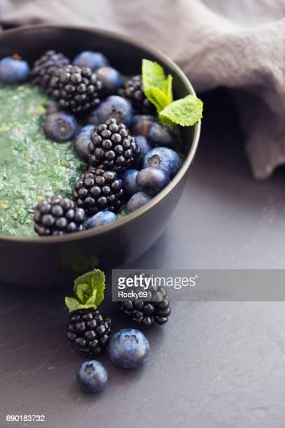 Healthy organic spirulina porridge topped with berries