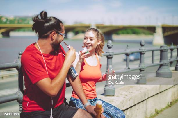 healthy outdoors exercising - man eating woman out stock photos and pictures