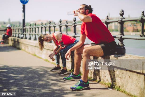 healthy outdoors exercising - heterosexual couple stock pictures, royalty-free photos & images