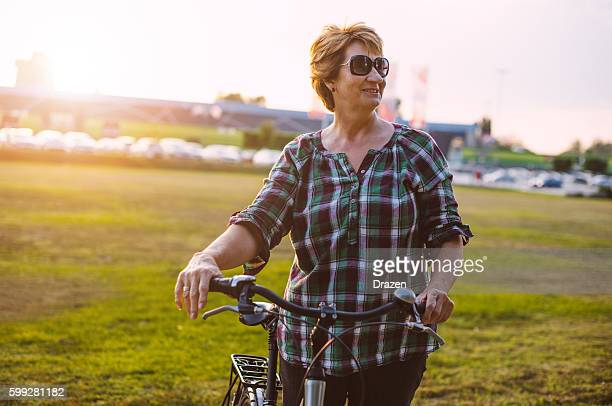 Healthy overweight woman riding bicycle