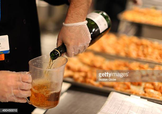 Healthy patient meals at Spaulding Rehab Hospital Marsala wine is poured into a measuring cup to marinate chicken