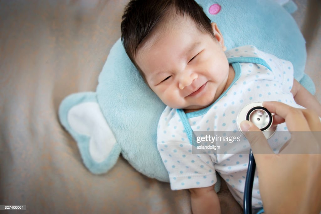 healthy people concept. Asian adorable baby infant laughing with happy face for good health on doctor check up time : Stock Photo