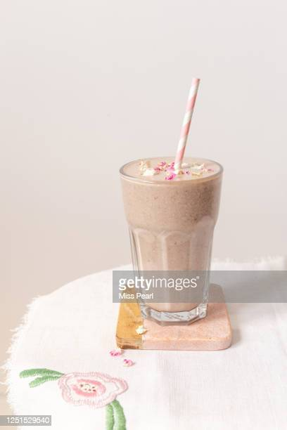healthy pink berry smoothie drink with paper straw - kildare stock pictures, royalty-free photos & images