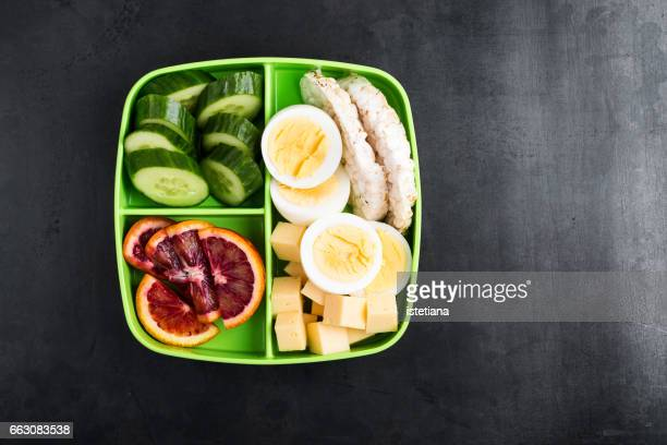 healthy protein snack box with cheese, hardboiled eggs - cracker snack stock photos and pictures