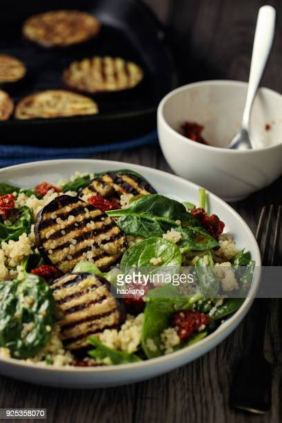 Healthy quinoa and grilled aubergine and spinach  salad