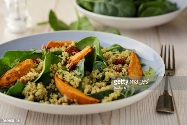 Healthy quinoa salad with roasted sweet potatoes wedges