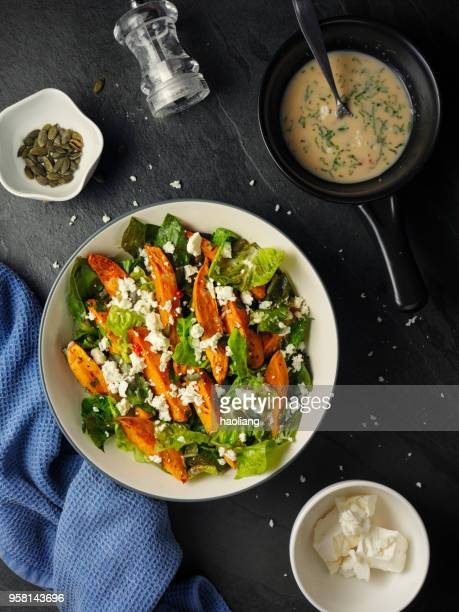 healthy roasted sweet potatoes salad - romaine lettuce stock photos and pictures