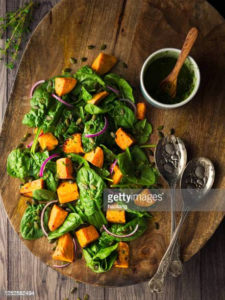healthy roasted sweet potato,spinach vegan salad - spinach stock pictures, royalty-free photos & images