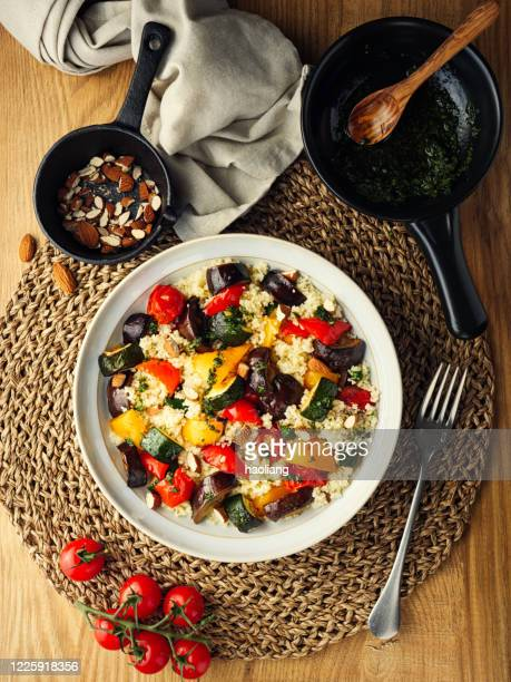 healthy roasted vegetable couscous salad bowl - couscous stock pictures, royalty-free photos & images