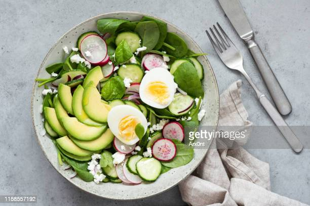 healthy salad bowl table top view - salad stock pictures, royalty-free photos & images