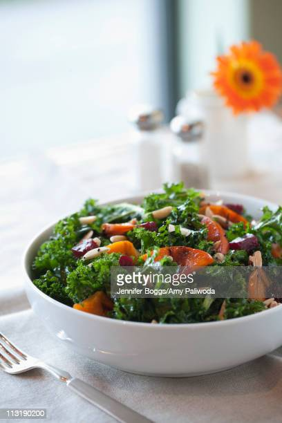 healthy salad in bowl - kale stock photos and pictures