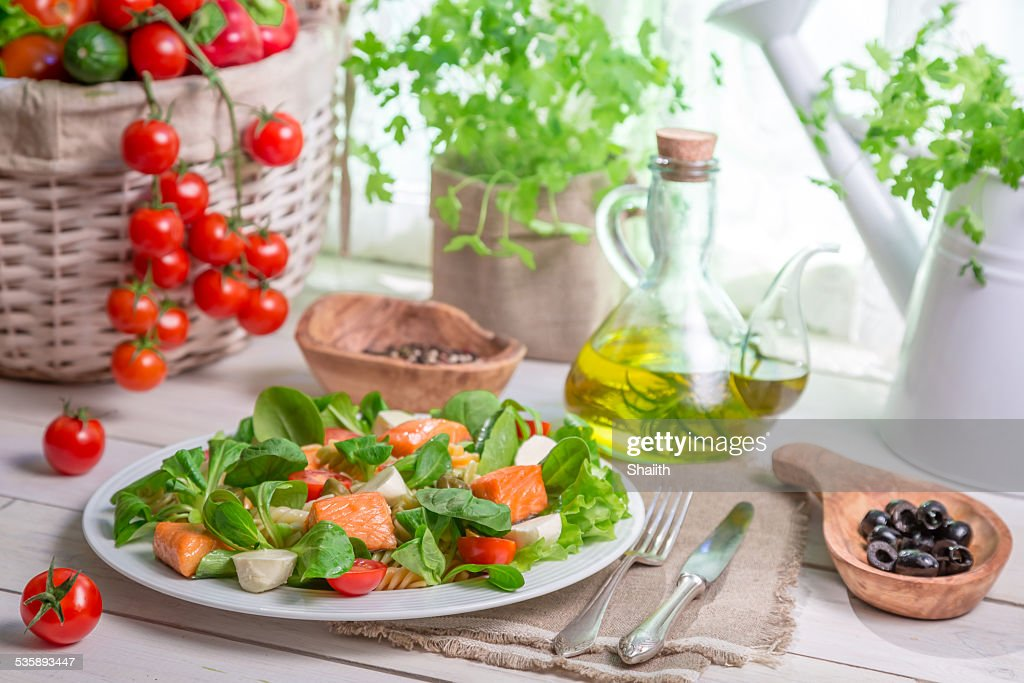 Healthy salad with fresh vegetables and salmon : Stock Photo