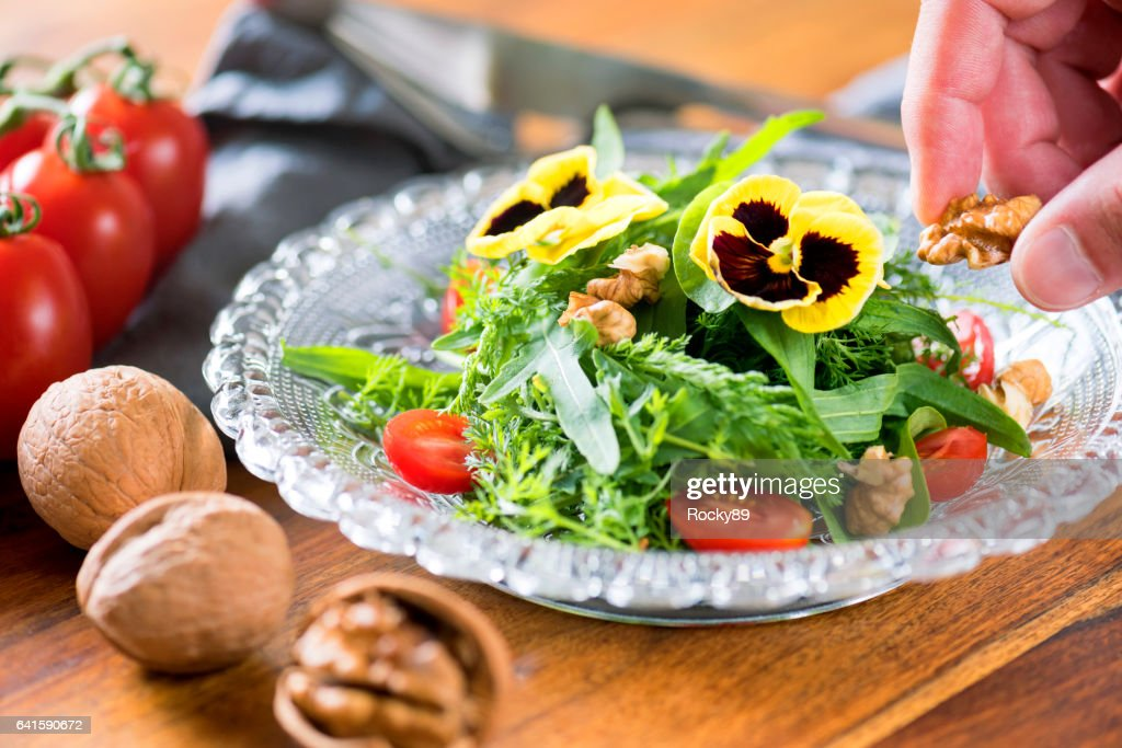 Healthy Salad with Wild Herbs and Edible Flowers : Stock Photo