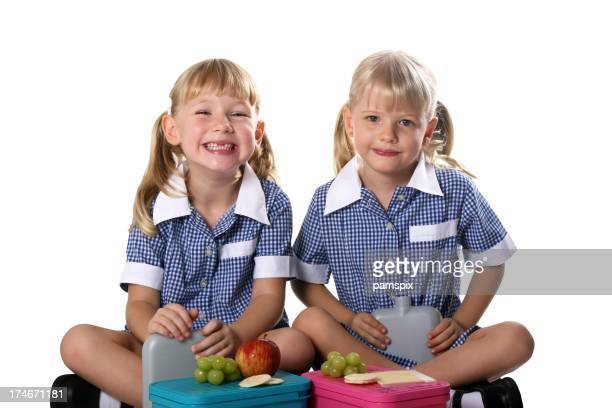 Healthy School Girls eating lunch on white background