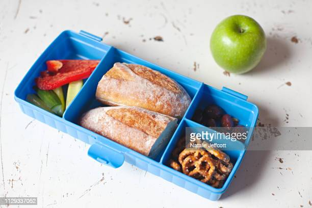 healthy school or work lunch box with sandwich, vegetables and fruit in australia - lunch box stock pictures, royalty-free photos & images