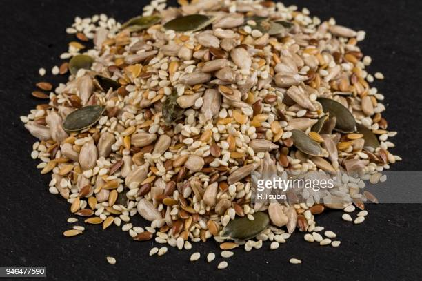 healthy seeds mix - black seed oil stock pictures, royalty-free photos & images