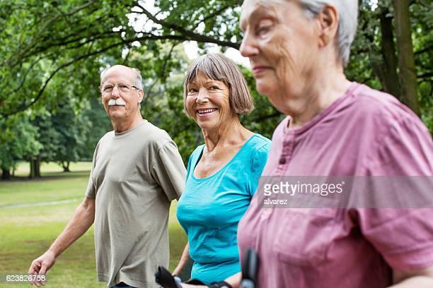Healthy senior people walking in park