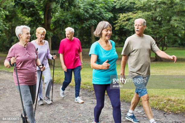 Healthy senior people walking in park