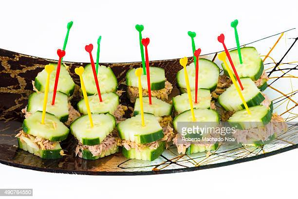 Healthy snacks for diabetics tuna and cucumber sandwiches or finger foods made of tuna sandwiched in cucumber slices arranged in a decorative curved...