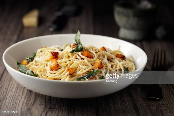 healthy spaghetti with roasted butternut squash and sage butter - pasta stock pictures, royalty-free photos & images