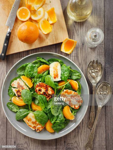 healthy spinach and orange salad with grilled halloumi cheese - spinach stock pictures, royalty-free photos & images