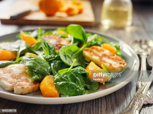 Healthy spinach and orange salad with grilled halloumi cheese