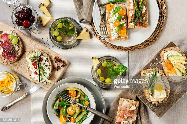 Healthy toast made with asparagus, cheese, egg and avocado served with a fresh salad