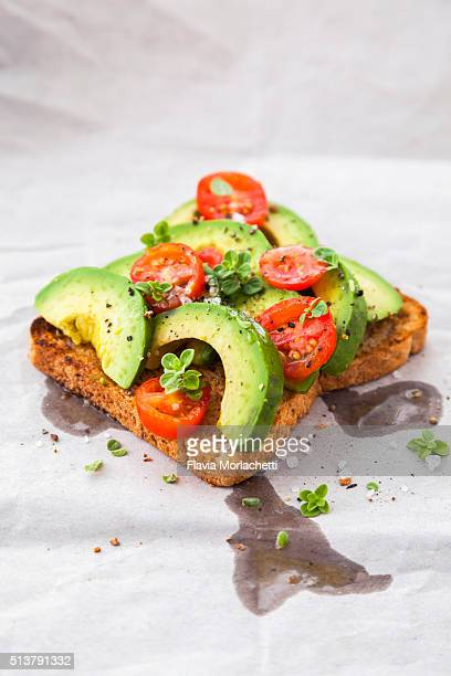 Healthy toast with avocado and cherry tomatoes