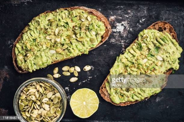 healthy toast with avocado - toasted bread stock pictures, royalty-free photos & images