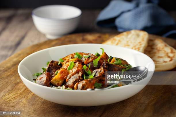 healthy vegan aubergine masala with long grain rice and naan bread - vegetarian food stock pictures, royalty-free photos & images