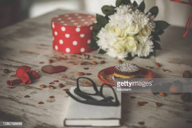 healthy vegan cake and a good book makes valentine's celebration fulfilled - embellishment stock pictures, royalty-free photos & images