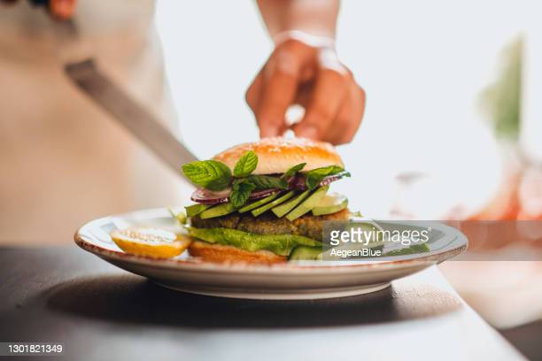 healthy vegan chickpea burger - veggie burgers stock pictures, royalty-free photos & images