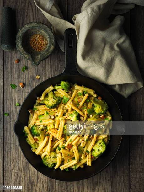 healthy vegan gluten free pasta with grilled broccoli and almond - crockery stock pictures, royalty-free photos & images