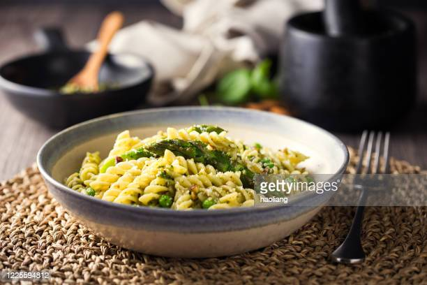 healthy vegan pasta bowl - bowl stock pictures, royalty-free photos & images