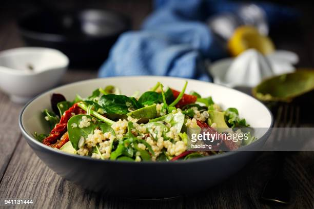 healthy vegan quinoa spinach salad - spinach stock pictures, royalty-free photos & images