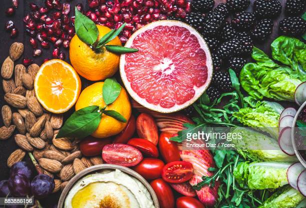 healthy vegan snack board pink grapefruit - nut food stock photos and pictures