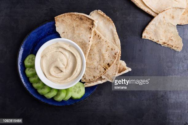 healthy vegan snack, hummus with pita bread and cucumber - dipping sauce stock pictures, royalty-free photos & images