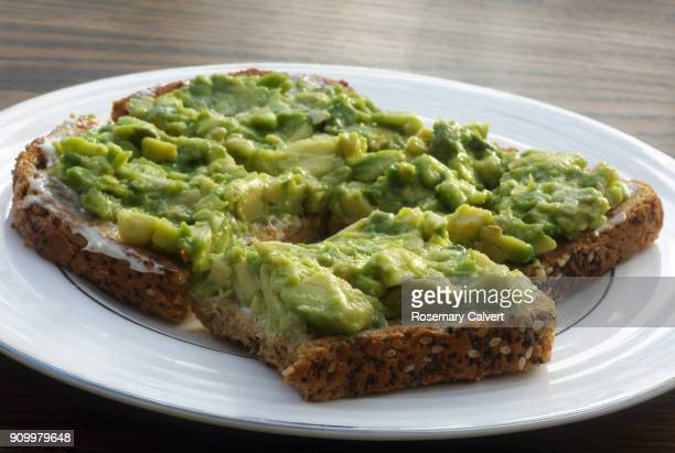 healthy vegan snack of avocado on toast. - avocado stock pictures, royalty-free photos & images