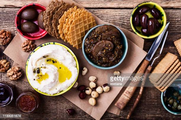 healthy vegan snack. white beans hummus, roasted eggplant with mushrooms - greek food stock pictures, royalty-free photos & images